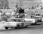 Hometown favorite Dan Gurney leads the pack in Sunday's 500 mile stock car enduro