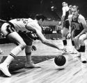 Los Angeles' Rudy LaRusso dribbles low to the court