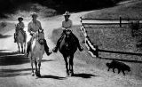 Ronald and Nancy Reagan ride down a trail