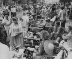 Crowd of shoppers at rummage sale