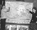 Students study war map