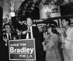Mayor Bradley waves to supporters