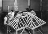 Students constructing a scale model roof