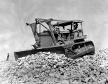 Bulldozer smoothes crushed rocks