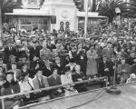 Crowd watches pageant, Victory House