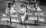 Children carry anti-nuke sign in parade