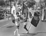 Two boys with Mexican flags in parade