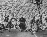Gary Beban scrambles for a Bruin first down