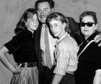 Errol Flynn with his daughters