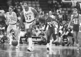 New Jersey Nets try to stop Magic Johnson