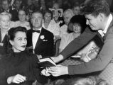 Hedy Lamarr signs autograph book at premiere