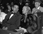 Fritz Lang with Miriam Hopkins at outdoor premiere
