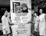Women in front of tribute poster to Lucille Ball