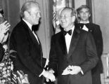 Leonard Firestone congratulated by Gerald Ford