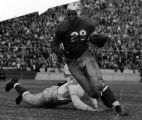 Jackie Robinson avoiding a tackle