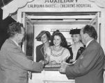 Actress Shirley Temple at auxiliary booth for War Bonds and Stamps