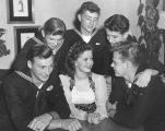 Actress Shirley Temple and a few Navy men