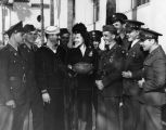 Rita Hayworth met by service men