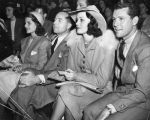 Rita Hayworth and group enjoy Roller Derby