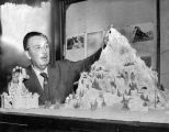 Walt Disney displays model of Matterhorn
