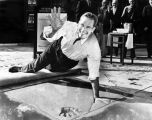 Actor Charlton Heston puts his prints in concrete