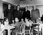 Housing officials pose with children, Ramona Gardens