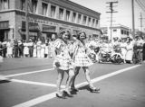 Twins walk in Santa Monica parade