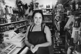 Woman cashier in market, Echo Park