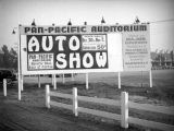 Auto show billboard at the Pan-Pacific Auditorium