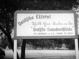 Sign in Hindenburg Park for German Saturday evening classes at the 17th Street School