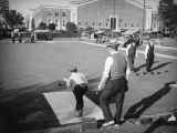 Lawn bowling in Exposition Park by the Armory Building