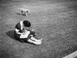 Woman and dog at Los Angeles Junior College