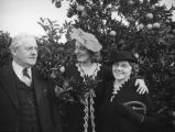 Ethel Schultheis and parents at an orange grove near Piru