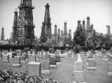 Graves and oil wells at Sunnyside Cemetery in Long Beach