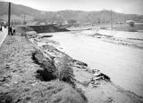 L.A. River flooding, destruction in a river channel, Universal City