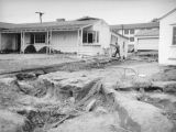 L.A. River flooding, inspecting a damaged house in North Hollywood
