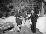 Big Pines Recreation Camp, Ethel Schultheis on a stump with friends