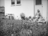 Herman Schultheis on the steps at home