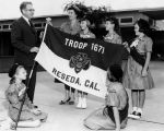 Reseda Kiwanis present flag to Girl Scouts