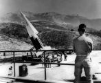Soldier stands guard over poised Nike guided missile