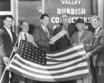Receives flag flown over capitol