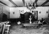 Three feet of mud cover formal dining room of Stetson home