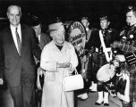 Dame Flora MacLeod, center, Tenneson Twitchell arrive in Los Angeles