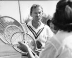 Steve Cornell gives tennis lesson to young ladies