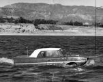 Snub-nosed 'Amphicar' rides choppy waves of Hansen Lake in Pacoima