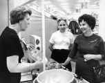 Mrs. Kirkpatrick, left, answers homemakers' questions
