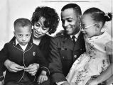 New astronaut poses with wife and children