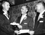 T. F. Dixon, right, and S. K. Hoffman, center, receive awards