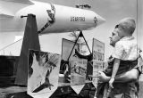 Father, son view deadly missiles model