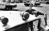 Sgt. Curtis Spradling of the LAPD's North Hollywood division looks at stand-out lights, siren